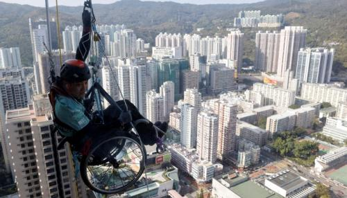 In Wheelchair, Paraplegic Lai Chi-Wai Climbs up Skyscraper in Hong Kong