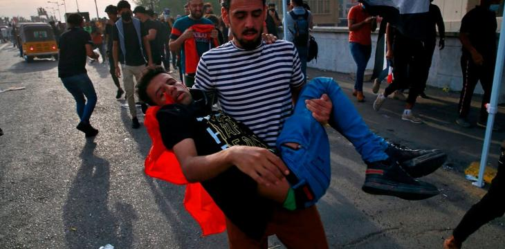 Iraqis Mark One Year of Protests Amid Clashes and Injuries